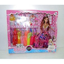 Кукла с нарядами и ребенком